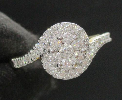 แหวน เพชรกระจุกกลม 7/0.16 ct ฝังเพชรข้าง 24 เม็ด 0.24 กะรัต ทอง18K หลุดจำนำ งานสวยมาก นน. 2.74 g