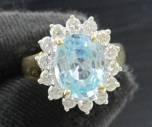 แหวน บลูโทพาส เจียร ล้อมเพชร 14 เม็ด 0.42 กะรัต ทอง90 งานดีไซน์สวย นน. 5.26 g