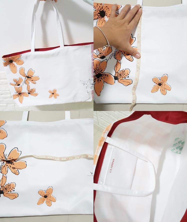 กระเป๋าผ้าหนาใบใหญ่จาก Clarins สีขาวชมพู ด้านนึงพื้นขาวลายดอกไม้ ของแท้ 1