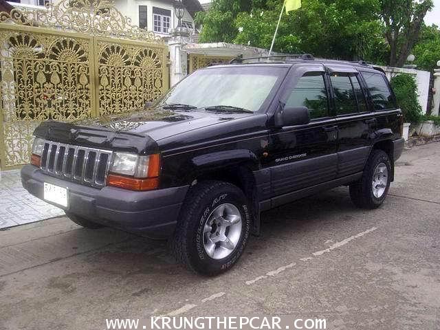 .ขาย JEEP GRAND CHEROKEE 4.0LAREDO 4WD ปี 1998 สีดำ ออโต้ 2AIRBAGไม่เคยชน$A02-5169