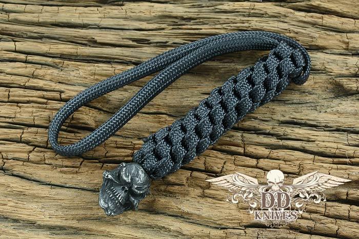 Lanyard สำหรับห้อยมีด Schmuckatelli Black Oxidized Pewter Grins Skull Lanyard, Black (GBLBB)