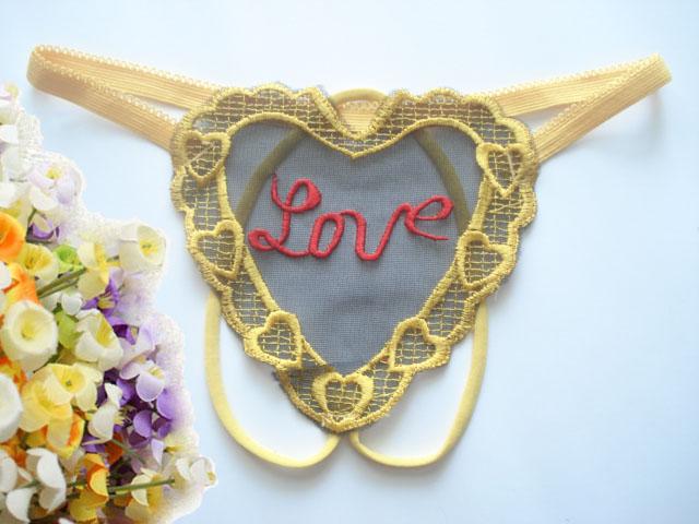 OP-015-Y กางเกงในจีสตริงเปิดเป้ารูปหัวใจ สีเหลือง