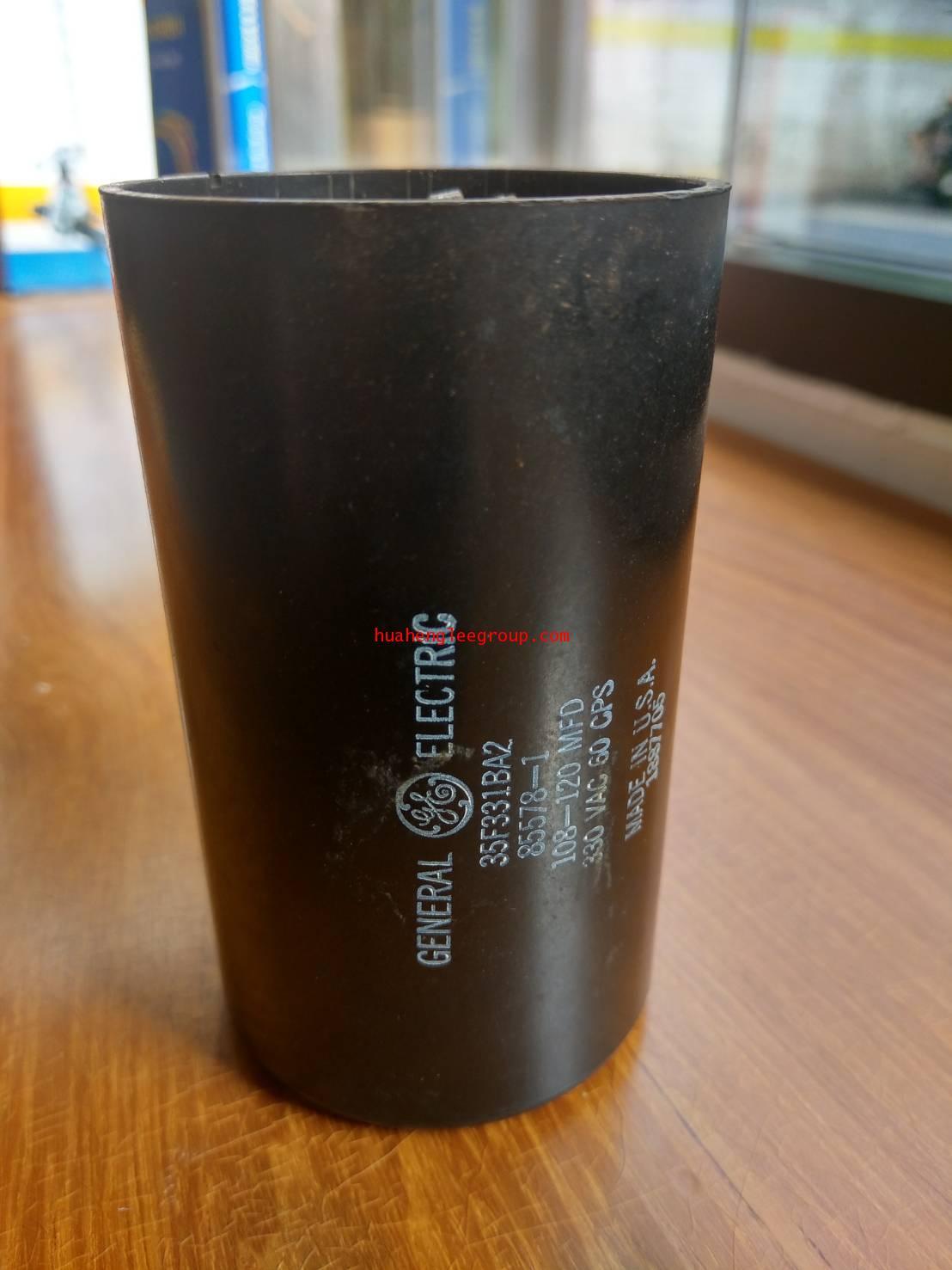 สตาร์ท คาปาซิเตอร์ - แคปสตาร์ท (ตัวพลาสติกกลม สีดำ) หัวเสียบ 108-120uF 330V \'GE\' ตัวใหญ่ (สินค้าลด