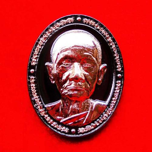 เหรียญหน้ายักษ์ หลวงปู่บุญมา สำนักสงฆ์เขาแก้วทอง เนื้อแบล็คโรเดียมลายนาก เลขสวย 31
