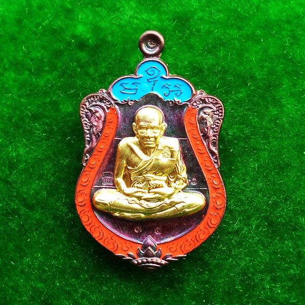 1 ใน 200 เหรียญหลวงพ่อทวด รุ่นอรหันต์กายเทพ วัดหนองเอี่ยวใน เนื้อทองแดงมันปูลงยา2สี หน้ากากทองระฆัง