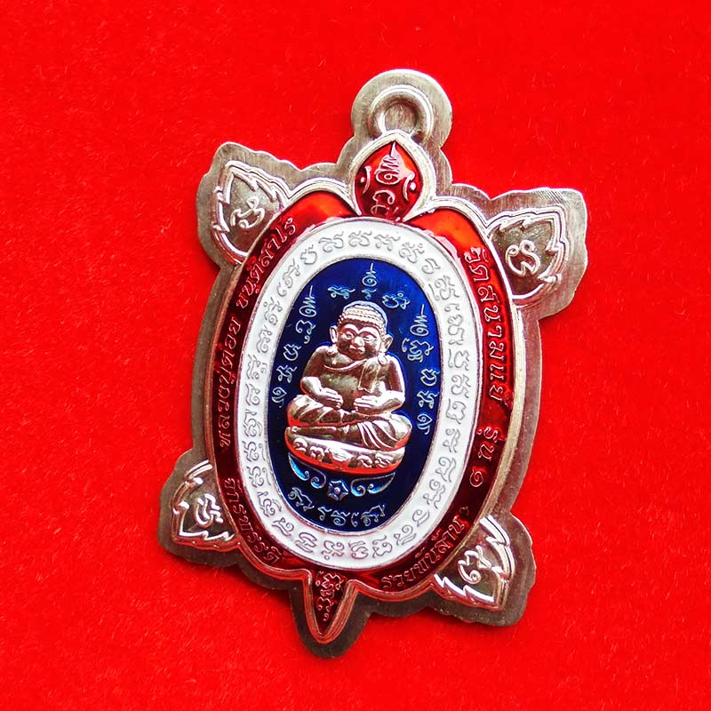 เหรียญพญาเต่าเรือน จักรพรรดิ์รวยพันล้าน รุ่น 1 หลวงปู่ต๋อย เนื้ออัลปาก้าไม่ตัดปีกลงยาธงชาติ เลข 299