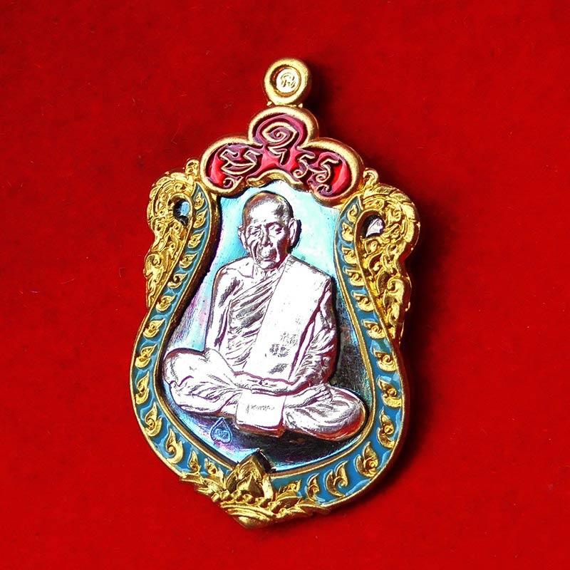 เหรียญหลวงปู่ทิม รุ่นมหาบารมี ๕๙  เนื้อทองแดงมันผิวรุ้ง หน้ากากเงิน ขอบปลอกลูกปืนลงยา 2 สี