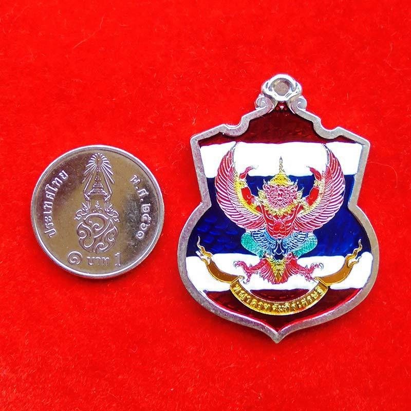 เหรียญพญาครุฑ รุ่นคัมภีร์เศรษฐี เนื้ออัลปาก้าลงยาลายสีธงชาติ หลวงปู่สอ วัดบ้านขาม ปี 2560 เลข 21 2