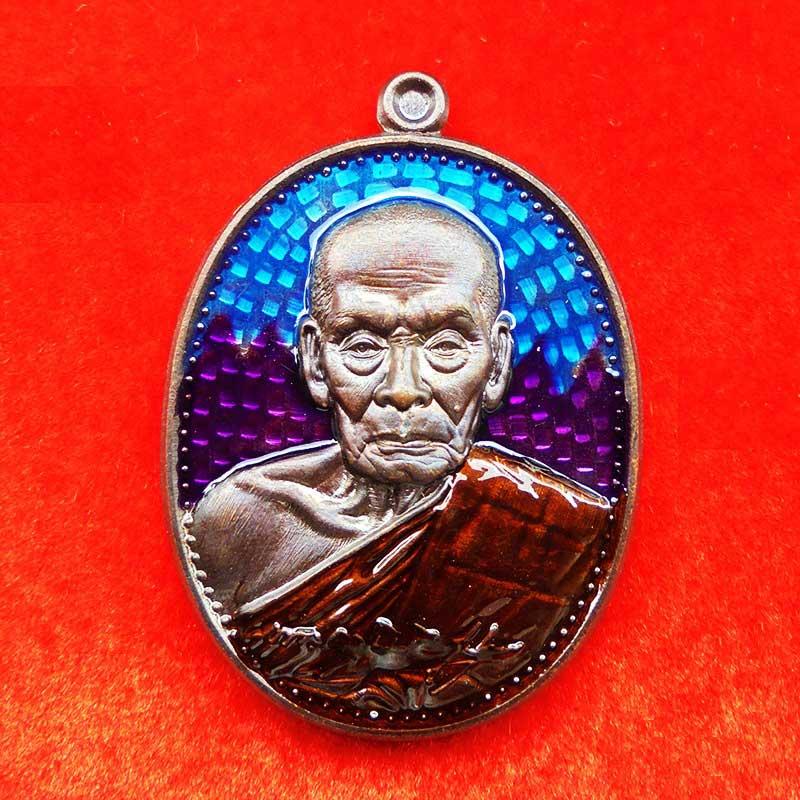 เหรียญหลวงพ่อพัฒน์ วัดห้วยด้วน รุ่นเจริญยศ เนื้อทองแดง ลงยาสีฟ้า-ม่วง จีวรส้ม ปี 2563 เลข 85