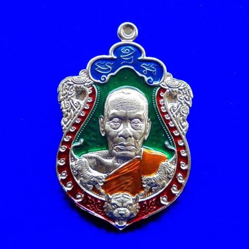 เหรียญเสมาพยัคฆ์ราชาทรัพย์ หลวงพ่อพัฒน์ วัดห้วยด้วน เนื้ออัลปาก้าลงยา 4 สี ปี 2564 เลข 140