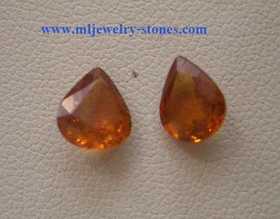 พลอยสปีเนลสีส้มทรงหยดน้ำ ไฟดี น้ำสะอาด เหมาะสำหรับทำต่างหู น้ำหนัก 3.5 กะรัต