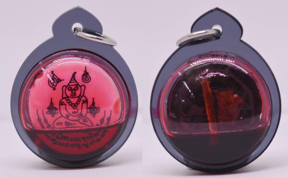 ล็อกเก็ตพญางั่งตาแดง เลี่ยมน้ำมันเสน่ห์แดงกามสูตร อาจารย์พรต สำนักปู่เสน่ห์โคบุตร 2562