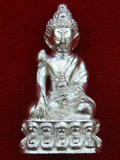 พระกริ่งสายรกพระพุทธเจ้ารุ่นแรก หลวงปู่บุญ วัดแสงน้อย อุบลราชธานี เนื้อเงิน