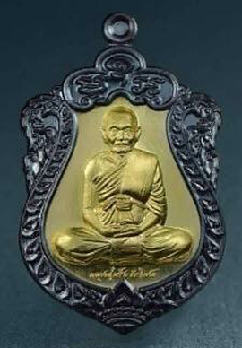 เหรียญเสมามหาโภคทรัพย์ (นั่งเต็มองค์) เนื้อทองแดงรมดำหน้ากากทองระฆังคอน้ำเต้า