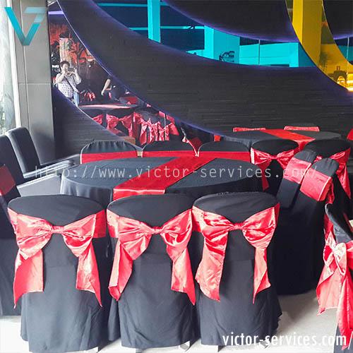 เช่าโต๊ะจีน + เก้าอี้ พลาสิตกคลุมผ้าดำ + โบว์แดง 1