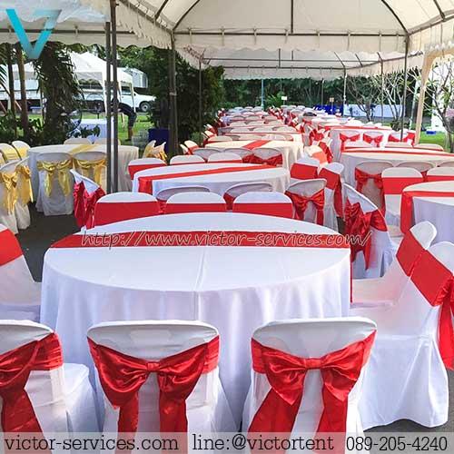 เช่าโต๊ะจีน -เก้าอี้พลาสติกคลุมผ้า ผูกโบว์สีแดง