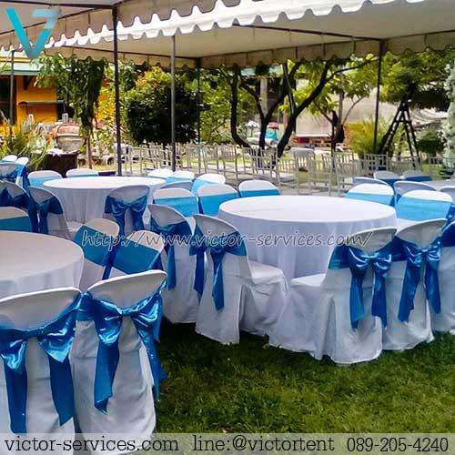 เช่าโต๊ะจีน -เก้าอี้พลาสติกคลุมผ้า ผูกโบว์สีฟ้า