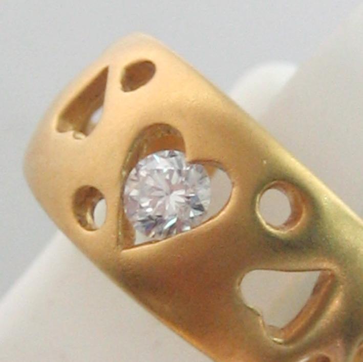 แหวนทองคำประดับเพชรแท้เม็ดเดี่ยวขนาด 0.15 กะรัต ตัวเรือนทอง 90 ฉลุลวดลายหัวใจ น้ำหนักทองรวม 4.4 กรั 1