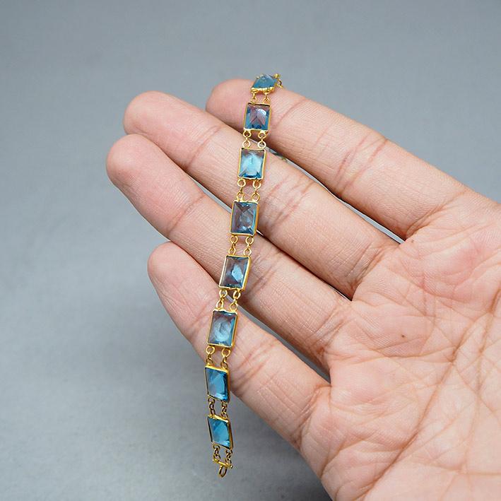 สร้อยข้อมือทองคำประดับพลอยฟ้าใส blue topaz 12 เม็ด ตัวเรือนทอง 90 ตัวเรือนกว้าง 6.5mm ความ 18cm น้ำ