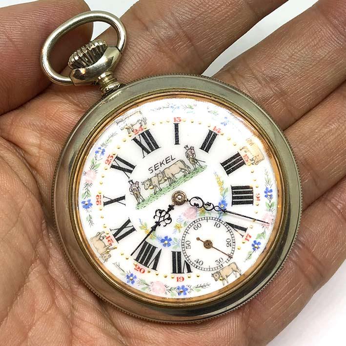 นาฬิกาพกไขลาน SEKEL Pocket watch 1900 ขนาดตัวเรือน 54 mm หน้าปัดกระเบื้องขาวพิมพ์โรมันดำ และลวดลายตุ