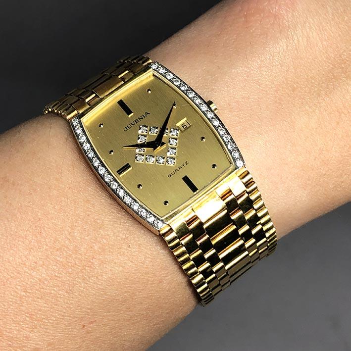 JUVENIA Diamond Quartz date ใส่ได้ทั้งชาย หญิง ขนาดตัวเรือน 27x35 mm หน้าปัดสีทองประดับหลักเวลาขีดสล