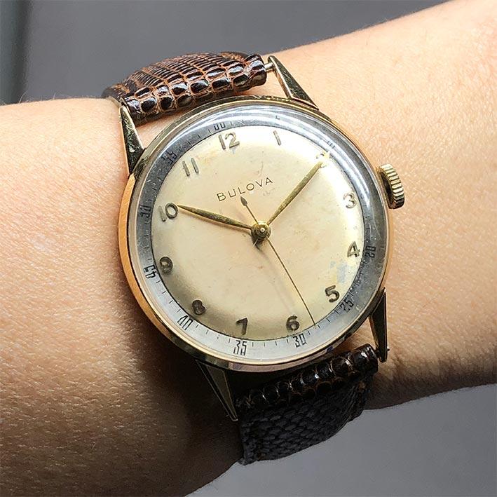 นาฬิกาวินเทจ BULOVA 1950 ระบบไขลาน ขนาดตัวเรือน 32.5mm หน้าปัดบรอนซ์เงินประดับหลักเวลาขีดอารบิคทอง เ