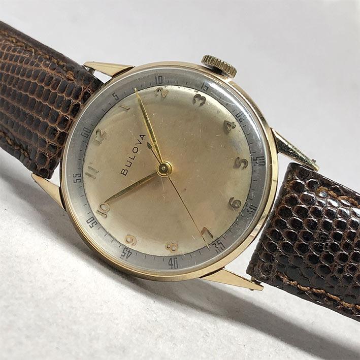 นาฬิกาวินเทจ BULOVA 1950 ระบบไขลาน ขนาดตัวเรือน 32.5mm หน้าปัดบรอนซ์เงินประดับหลักเวลาขีดอารบิคทอง เ 1