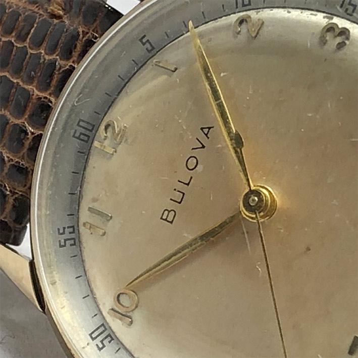 นาฬิกาวินเทจ BULOVA 1950 ระบบไขลาน ขนาดตัวเรือน 32.5mm หน้าปัดบรอนซ์เงินประดับหลักเวลาขีดอารบิคทอง เ 2